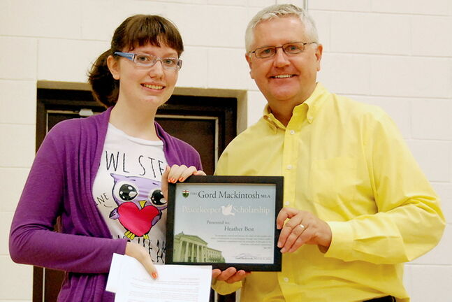 St. Johns MLA Gord Mackintosh presents the 2013 Peacekeeper Award to Heather Best, a Grade 8 honours student at �cole Seven Oaks Middle School.