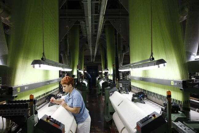 A worker adjusts brocade in a loom at the Veba textile factory in Broumov, Czech Republic, Tuesday, Sept. 25, 2012. When the managers of a textile factory in northern Czech Republic declared they would focus sales on Africa, their bankers, insurers and suppliers shook their heads in disbelief. A decade later, the decision is paying off. While the textile industry in Europe is under pressure from low-cost competition in Asia, the Czech company Veba is working around the clock to meet demand for the high-quality brocade it ships to Muslims and elites in western Africa. The textiles are of a better quality than those shipped in from China and have become a favorite among Africa�s Mecca-bound pilgrims. (AP Photo/Petr David Josek)