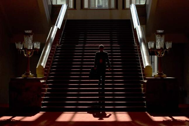 A People's Liberation Army officer walks down stairs with a document holder inside the Great Hall of the People where the closing ceremony for the 18th Communist Party Congress is held in Beijing Wednesday, Nov. 14, 2012. President Hu Jintao stepped aside as Communist Party leader to clear the way for Vice President Xi Jinping to take the helm in China. (AP Photo/Alexander F. Yuan)