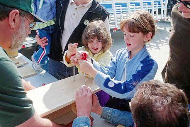 Youngsters building wood duck houses. Ducks Unlimited says helping wood ducks nest enhances the environment of many wetlands areas.