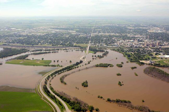 Flood water covers the Assiniboine River Valley in Brandon on Saturday morning, hours ahead of the expected first crest.