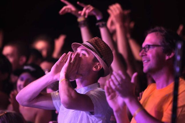 Ozomatli gets the crowd up and jumping as they  perform on the Main Stage at the 39th annual Winnipeg Folk Festival at Birds Hill Park Thursday night. Ruth Bonneville / Winnipeg Free Press