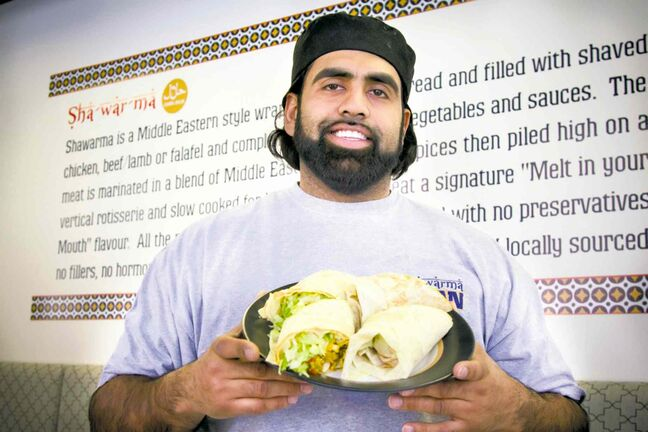 "Ibrahim ""Obby"" Khan, pictured at his restaurant Shawarma Khan, says it's important to help fight hunger year-round."