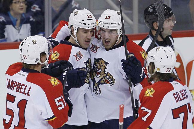 Florida Panthers' Brian Campbell (51), Shawn Matthias (18), Jimmy Hayes (12) and Tom Gilbert (77) celebrate goal Matthias' goal against the Winnipeg Jets during the first period.