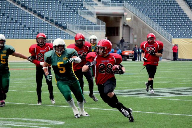 St. Vital Mustangs running back Brandon Sitch (28) moves the ball up the field in the team's championship game against the North Winnipeg Nomads over the weekend.