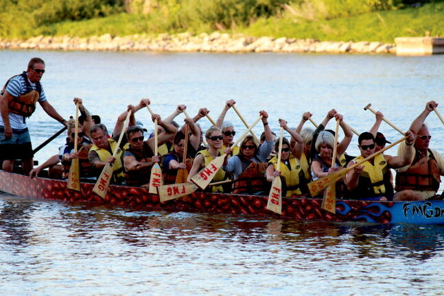 The C-Shells dragon boat team get some practice in on Monday night on the Red River at The Forks.
