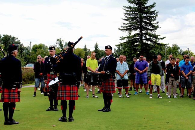 Golfers observe a moment of silence at the Winnipeg Police Service's 4th annual Community Challenge Fundraising Golf Tournament on Sept. 11 to remember those who died as a result of the 9/11 terrorist attacks 12 years ago.