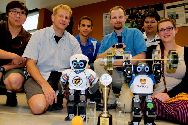 From left: Meng Cheng Lau, Dr. John Anderson, Tiago Araujo, Chris Iverach-Brereton, Josh Jung and Diana Carrier were part of the U of M team which led robots Jimmy and Jeff to victory at the 2013 HuroCup in Kuala Lumpur, Malaysia.