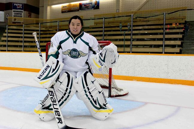 Samantha Wu, 17, is a goalie for the men's Linden Christian School Wings hockey team. She loves the experience of representing her school.