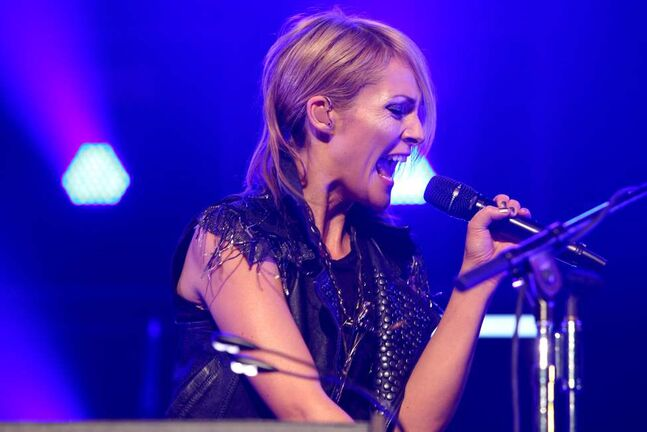 Emily Haines fronts Metric as they perform at the MTS Centre Saturday night. (Ruth Bonneville/Winnipeg Free Press)