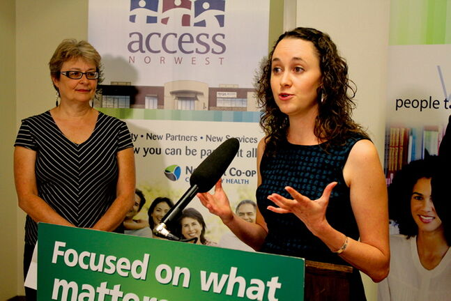 Kristina McMillan, director of the NorWest Co-op Community Food Centre, speaks at a press conference Wed., Aug. 21.