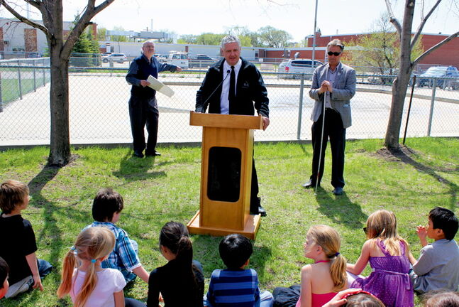 St. Johns MLA Gord Mackintosh (centre) and Mynarski Coun. Ross Eadie speak to a group of children during a spray pad announcement at the West Kildonan Memorial Community Centre last week. The pad will open in 2014.