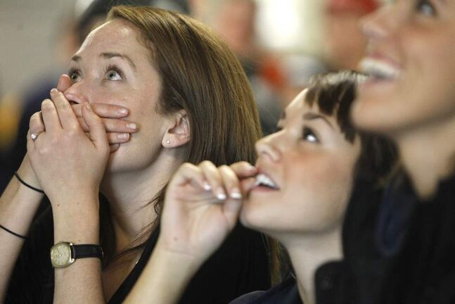 Rebecca Parkinson, Amanda Austin and Genevieve Mushaluk watch on tv as Felix Baumgartner jumps from a balloon, 36,576 metres above the earth, Sunday, October 14, 2012. (TREVOR HAGAN/WINNIPEG FREE PRESS)