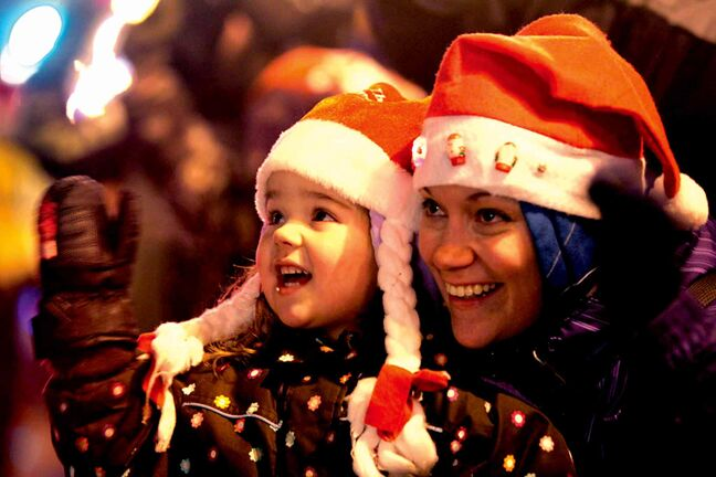 In this file photo from last year's Santa Claus Parade, three-year-old Makaela McMurray and her mom were all smiles as they waved to Santa on Portage Avenue.