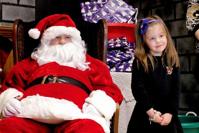 In this file photo, an attendee at last year's Lunch with Santa event, held at Norberry-Glenlee Community Centre, enjoys a visit with the man himself.