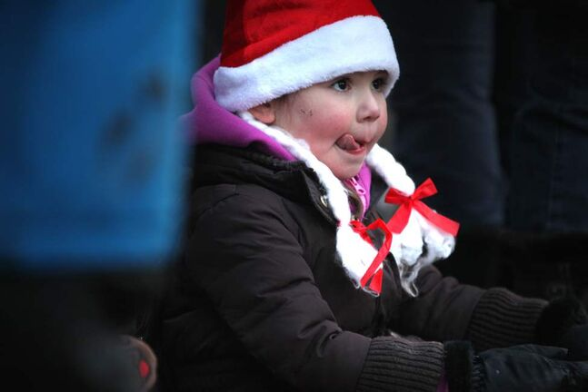 This little one is all eyes as she enjoys the parade. (Ruth Bonneville/Winnipeg Free Press)