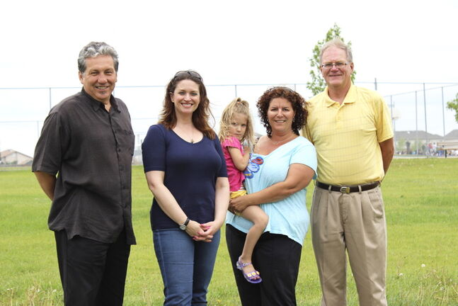 From left: Coun. Dan Vandal (St. Boniface), MLA for Southdale Erin Selby, vice-chair of the Island Lakes Residents' Group Rachelle Moore (and her daughter) and Lindsey Wilson, the group's chair, in Lindsey Wilson Park.