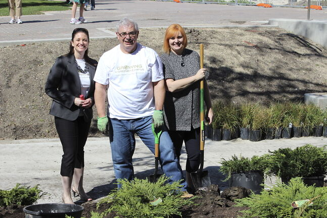 MLA for Southdale Erin Selby (left) and MLA for Fort Richmond Kerri Irvin-Ross (right) joined Dr. David Barnard, president and vice-chancellor of the University of Manitoba, on campus in Fort Garry on May 23 for the university's Beautification Day.