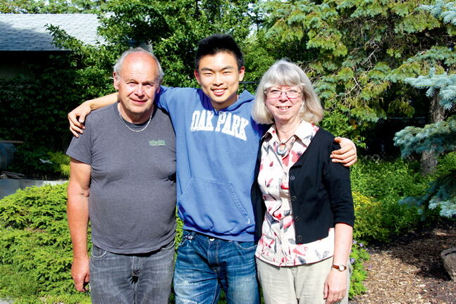 John and Beth Szuck with Bowen Zheng, a homestay student who stayed with them last year to attend Oak Park High School.
