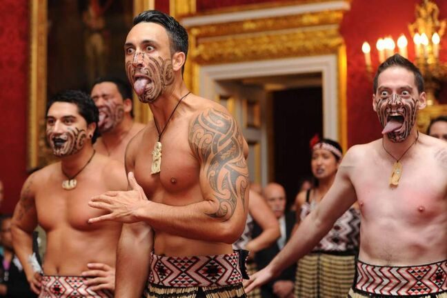 Maori dancers perform the traditional Haka for Britain's Prince Charles and his wife, Camilla, Duchess of Cornwall at St. James's Palace in central London on Wednesday, Oct. 24, 2012. The Prince of Wales and The Duchess of Cornwall met prominent Papua New Guineans, Australians and New Zealanders living in the UK from the world of business, sport, entertainment and the media during a reception, hosted by Their Royal Highnesses, at St James' Palace ahead of their tour. (AP Photo / Carl Court, Pool)