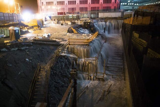 Sea water floods the Ground Zero construction site in New York. Sandy continued on its path, as the storm forcing the shutdown of mass transit, schools and financial markets, sending coastal residents fleeing and threatening a dangerous mix of high winds and soaking rain. (AP Photo/ John Minchillo)