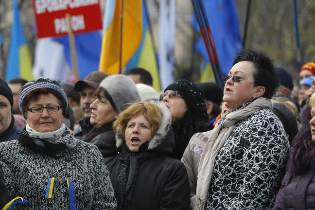 Women attend a rally in downtown Kiev, Ukraine, on Sunday. As many as 100,000 demonstrators chased away police to rally in the center of Ukraine's capital on Sunday, defying a government ban on protests on Independence Square, in the biggest show of anger over the president's refusal to sign an agreement with the European Union.
