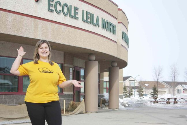 Natalie Brnjas is shown outside Leila North School, where she coaches Special Olympics athletes in track and basketball.