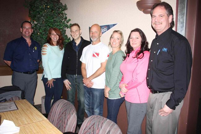 East St. Paul Chamber of Commerce members Corey DesJarlais (Community Safety Net and CSN Printing), Carrie Chick (Paradise Breeze Tanning and Day Spa), Johnathan Fahr (Fahr Group), Kevin Jones (Jonesy's Restaurant and Bar), Sarah Michaluk (Advanced Wound Healing and Foot Care), Tanya Missikewitz (Centum A Team), and Collin Bell (One Insurance) are shown at a meeting at Jonesy's on April 30.