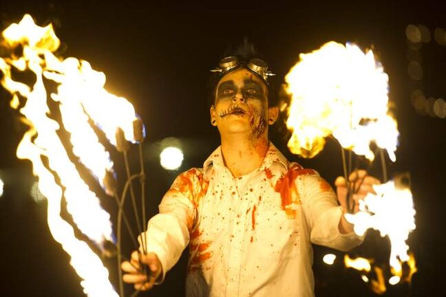 Fire performer at the Forks for the annual Winnipeg Zombie Walk from The Forks to The Manitoba Legislative Building Saturday night. 