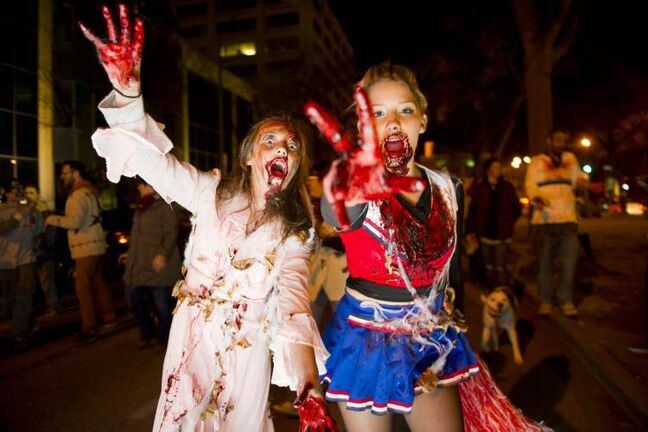 Zombies Olivia Daoust and Kameryn Castell during the annual Winnipeg Zombie Walk from The Forks to The Manitoba Legislative Building Saturday night.  DAVID LIPNOWSKI / WINNIPEG FREE PRESS