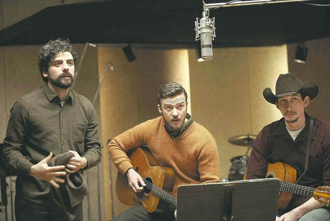 From left, Llewyn (Oscar Isaac), Jim (Justin Timberlake) and Al (Adam Driver) record the novelty song Please Mr. Kennedy.