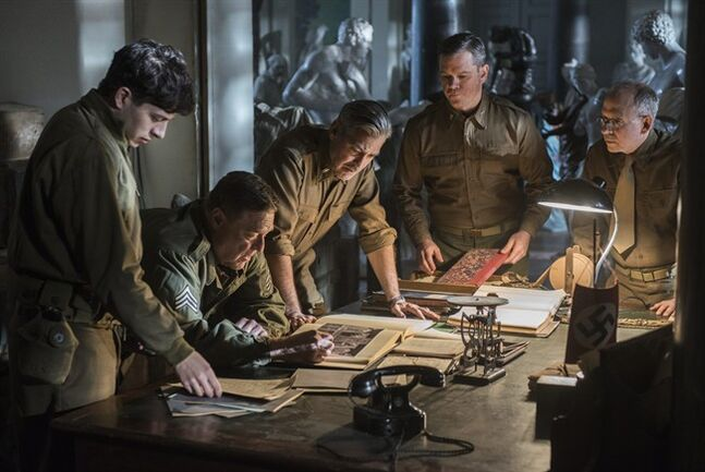 This image released by Columbia Pictures shows, from left, Dimitri Leonidas, John Goodman, George Clooney, Matt Damon and Bob Balaban in