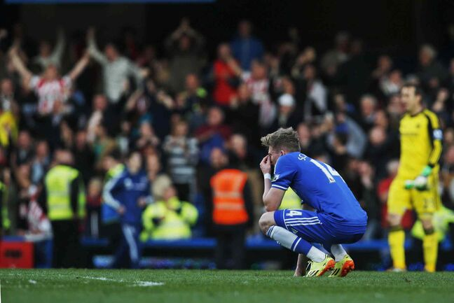 Shocked into paralysis by a stunning loss, Chelsea's Andre Schurrle remains glued to the pitch at Stamford Bridge following an inglorious 2-1 defeat to lightly regarded Sunderland.