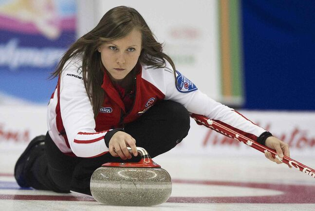 Team Canada skip Rachel Homan delivers her rock to team New Brunswick during draw 17 curling action at the Scotties Tournament of Hearts competition in Montreal, Friday, February 7, 2014.
