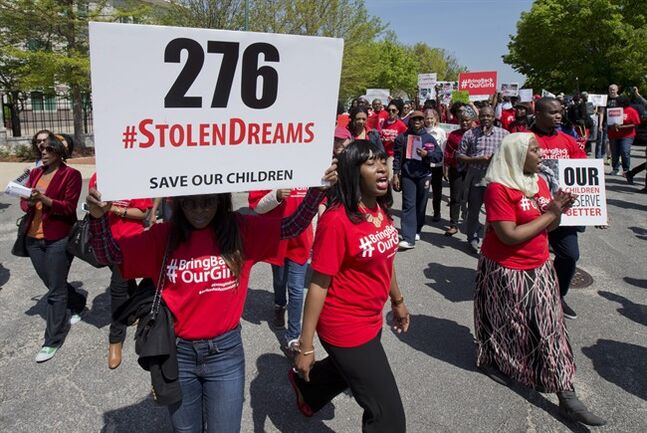 Protestors march in front of the Nigerian embassy in northwest Washington, Tuesday, May 6, 2014, protesting the kidnapping of nearly 300 teenage schoolgirls, abducted from a school in the remote northeast of Nigeria three weeks ago. (AP Photo/Manuel Balce Ceneta)