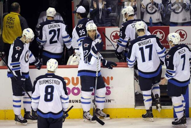 Winnipeg Jets players leave the ice after losing 5-3 to the Washington Capitals Tuesday.