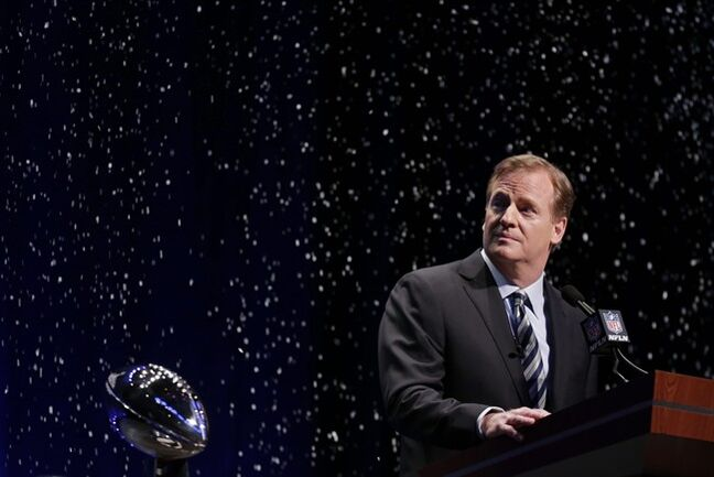 NFL comissioner Roger Goodell looks at artificial snow falls on stage as he speaks at a news conference Friday, Jan. 31, 2014, in New York. The Seattle Seahawks are scheduled to play the Denver Broncos in the NFL Super Bowl XLVIII football game on Sunday, Feb. 2, at MetLife Stadium in East Rutherford, N.J. (AP Photo/Charlie Riedel)
