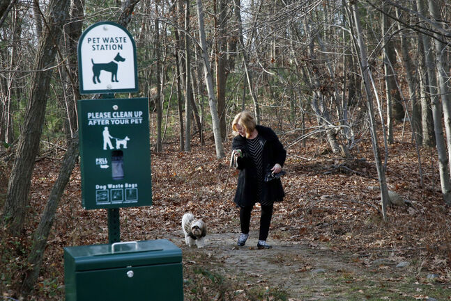 Kansky walks her dog Justine on the Devon Wood property.