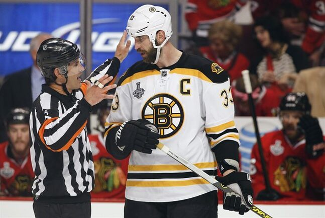 Boston Bruins defenseman Zdeno Chara talks with referee Wes McCauley during Game 2 of the NHL hockey Stanley Cup Finals, June 15, 2013, in Chicago. doesn't blend in with any crowd. At six-foot-nine, the Boston Bruins captain is noticeable whenever he's on the ice. THE CANADIAN PRESS/AP, Nam Y. Huh