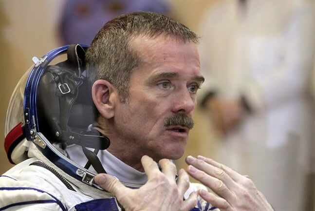 Canadian astronaut Chris Hadfield speaks during the pre-launch preparations at the Baikonur cosmodrome in Kazakhstan on Dec. 19, 2012. Hadfield is packing his bags as he wraps up his five-month mission aboard the International Space Station.Hadfield tweeted this morning that he
