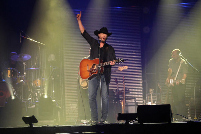 Country rocker Paul Brandt revs up the crowd during his concert last year at Westman Place in Brandon.