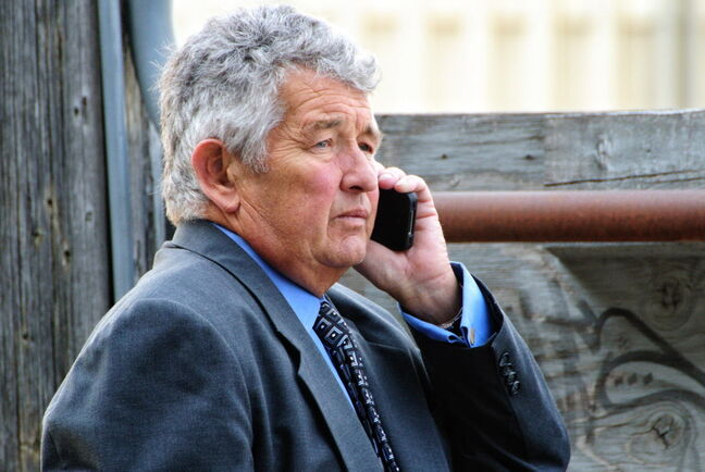 Jack King talks on the phone prior to giving testimony in the 2012 judiciary hearing of his wife, Justice Lori Douglas.
