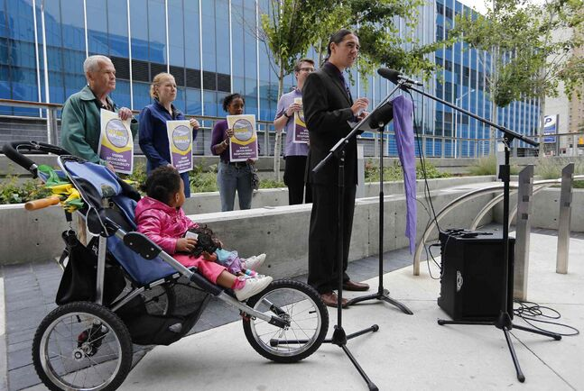 Robert-Falcon Ouellette spoke outside of the newly constructed police headquarters on the need for greater disclosure of information on from who is donating to mayoral and city council candidates' campaigns.