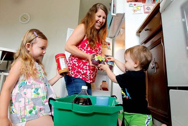 Kristin McKinley gets some help with the groceries from her daughter Danica, 4, and son Logan, 1.