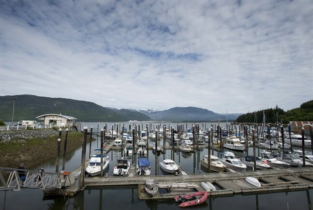Boats sit in a harbour in Kitimat, B.C., Tuesday, June, 17, 2014. The federal government is expected to announce later Tuesday their decision on whether the Northern Gateway pipeline will be allowed to go ahead. The pipeline, once built, would bring oil from Alberta to Kitimat on the British Columbia coast to be loaded on tankers and shipped around the world. THE CANADIAN PRESS/Jonathan Hayward