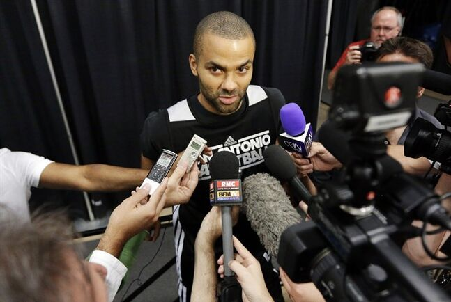 File-This June 15, 2013, file photo shows San Antonio Spurs' Tony Parker answering questions during a media availability after NBA basketball practice, , in San Antonio. Parker, a Belgian-born guard who plays for France and had a big international following even before signing with Peak last year, toured China, home of the world's second-largest economy, behind only the United States, last summer.
