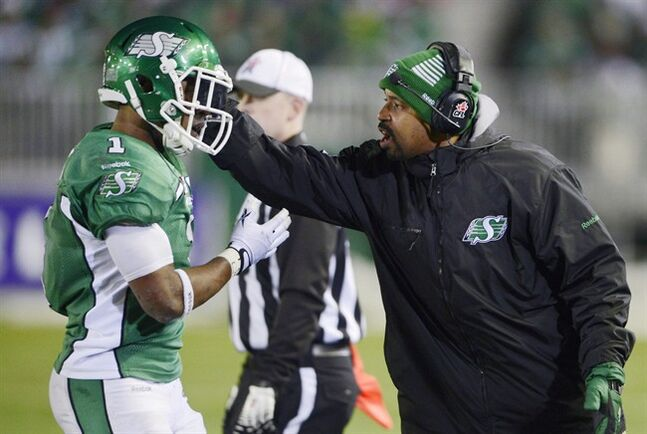 Khari Jones (right) talks to Roughriders Kory Sheets during Grey Cup action on November 24, 2013 in Regina. THE CANADIAN PRESS/Ryan Remiorz