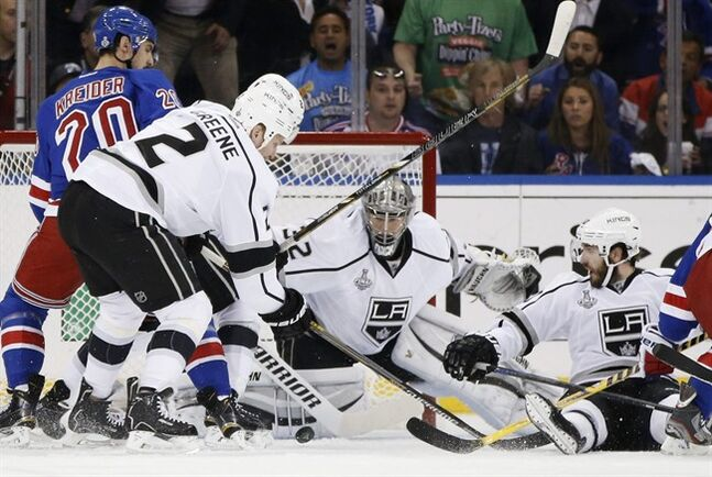 Los Angeles Kings goalie Jonathan Quick (32) looks for the rebound with defenseman Matt Greene (2) as New York Rangers left wing Chris Kreider (20) looks to score in the first period during Game 4 of the NHL hockey Stanley Cup Final, Wednesday, June 11, 2014, in New York. (AP Photo/Kathy Willens)