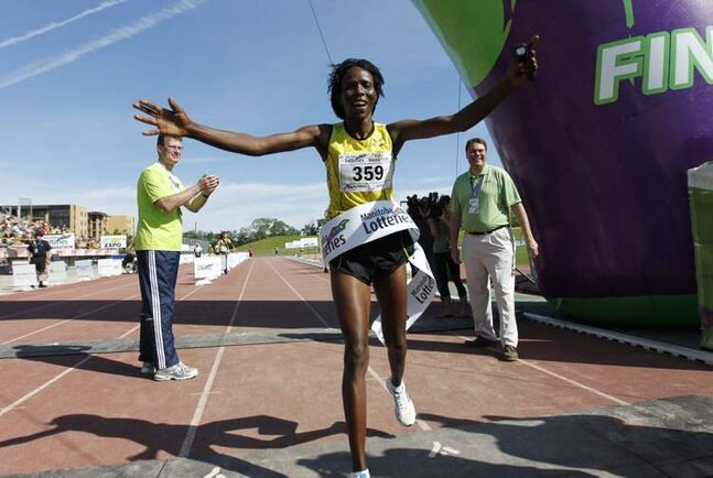 Anna Kibor was the first woman to cross the finish line in the 34th annual Manitoba full marathon with a time of 2:49:45.