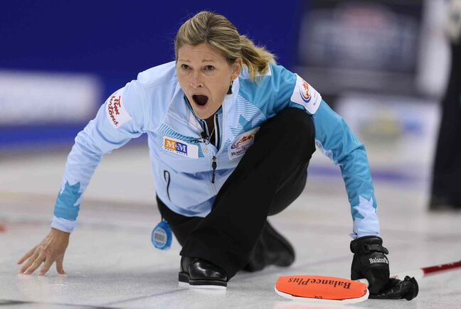 Skip Sherry Middaugh calls to her sweepers during action against Jennifer Jones in the women's final.